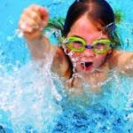 little girl taking charge swimming safety pool